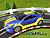 SCX Compact Toyota Celica Tuner blau/gelb